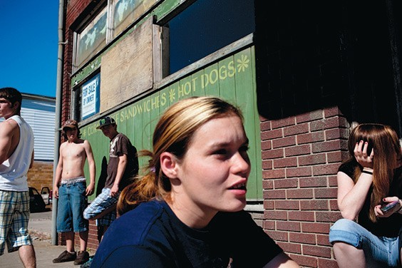Lisa Russel, 20, and other teens hang out on a street corner in Glouster, Ohio. Once a thriving community in Southeastern Ohio, the departure of extractive industries such as coal mining have caused the town's economy to dry up. Glouster's youth have little to do and substance abuse runs rampant.