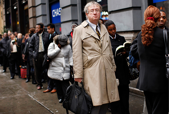 Eric Lipps, 52, waits in line to enter the NYCHires Job Fair in New York on December 9, 2009. U.S. employers cut 85,000 jobs in December, confounding expectations that the labor market was finally stabilizing and piling pressure on President Barack Obama to spur job growth.