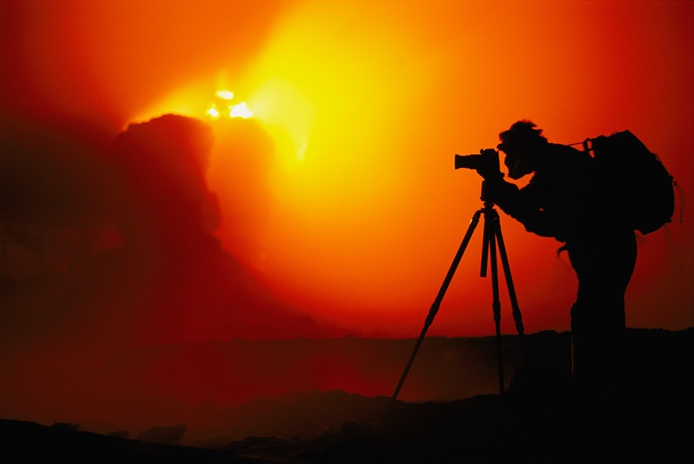 Frans Lanting at edge of volcano, Hawaii