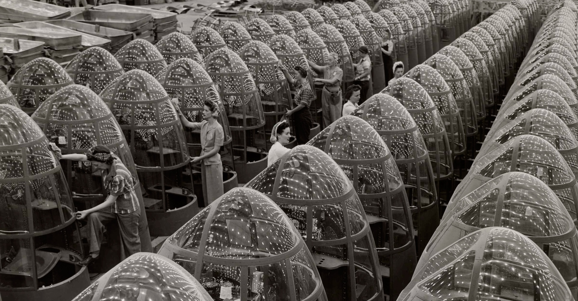 Women aircraft workers finishing transparent bomber noses for fighter and reconnaissance planes at Douglas Aircraft Co. Plant in Long Beach, California 1942