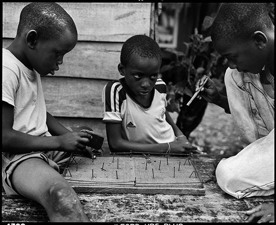 Children in Puente Nayero play an improvised game of table football.  The success of the Puente Nayero Humanitarian Space has encouraged residents on the neighboring street of Punta Icaco to begin organizing to create their own humanitarian space.