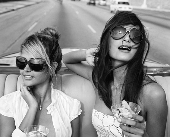 Giselle and Rachel cruising down the Malecón, Havana, from the series Habana Libre, 2009